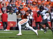 Clemson's Tavien Feaster rushes for a 70-yard touchdown while pursued by Louisville's Cornelius Sturghill during the first half of an NCAA college football game Saturday, Nov. 3, 2018, in Clemson, S.C. (AP Photo/Richard Shiro)