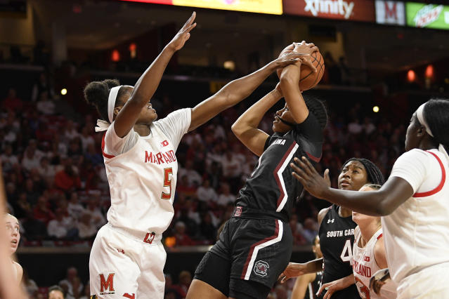 Maryland guard Kaila Charles (5) fouls South Carolina guard Zia Cooke (1) during the first half of an NCAA college basketball game, Sunday, Nov. 10, 2019, in College Park, Md. (AP Photo/Nick Wass)