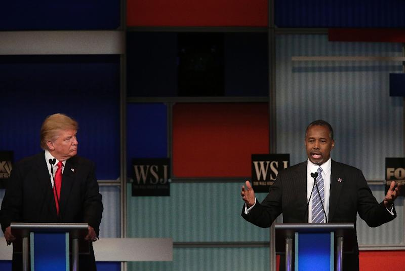 Republican presidential candidate Ben Carson (R), pictured with Donald Trump, has stumbled in recent days amid questions about the veracity of his inspirational personal narrative (AFP Photo/Joshua Lott)