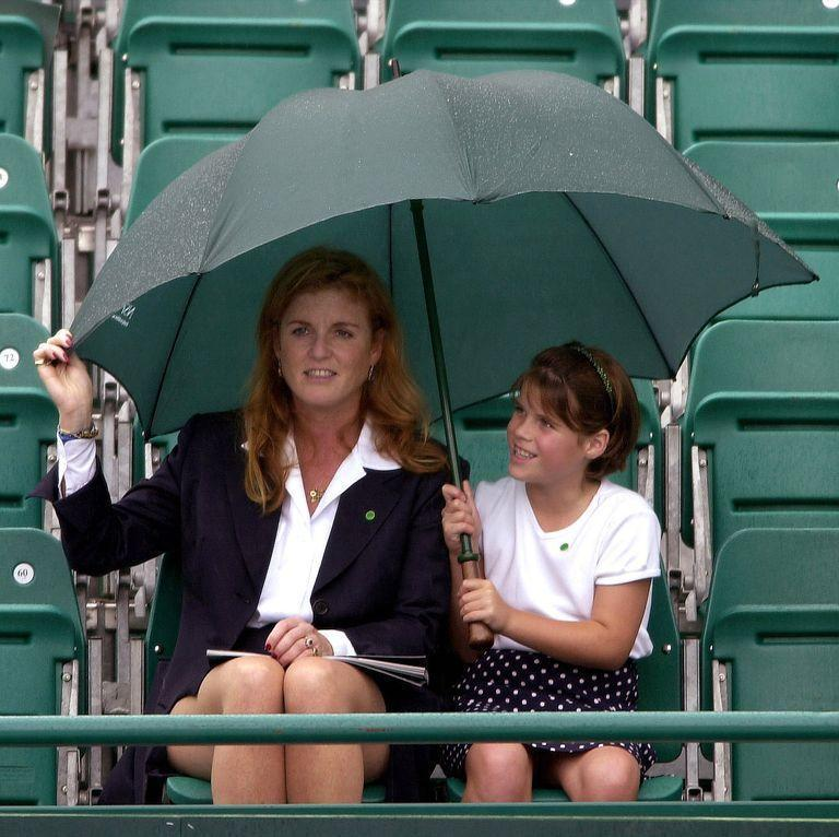 <p>A young Princess Eugenie, safely under an umbrella with her mother, seems undeterred by the bad weather. <br></p>