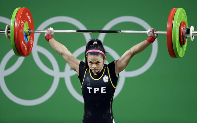 <p>Hsu Shu-Ching, of Taiwan, competes in the women's 53kg weightlifting competition at the 2016 Summer Olympics in Rio de Janeiro, Brazil, Sunday, Aug. 7, 2016. (AP Photo/Mike Groll) </p>