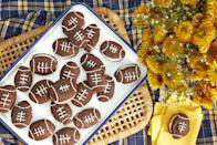 """<p>This year, of course, the pandemic has changed how we're celebrating everything, and football is no exception. While we may not be able to host the kinds of Super Bowl parties we did last year, we can still whip up a few snacks and take some time to watch <a href=""""https://www.countryliving.com/life/entertainment/a30421546/super-bowl-date-location/"""" rel=""""nofollow noopener"""" target=""""_blank"""" data-ylk=""""slk:this year's game"""" class=""""link rapid-noclick-resp"""">this year's game</a>—and all the commercials—and enjoy ourselves. And, of course, we need to celebrate with some food. You'll certainly want your fair share of <a href=""""https://www.countryliving.com/food-drinks/g2966/super-bowl-snacks/"""" rel=""""nofollow noopener"""" target=""""_blank"""" data-ylk=""""slk:Super Bowl appetizers"""" class=""""link rapid-noclick-resp"""">Super Bowl appetizers</a>, but we'd like to point your attention toward the wide array of easy Super Bowl desserts, at least one or two of which should definitely make an appearance at this year's party. <a href=""""https://www.countryliving.com/food-drinks/g1563/party-dip-recipes/"""" rel=""""nofollow noopener"""" target=""""_blank"""" data-ylk=""""slk:Dip recipes"""" class=""""link rapid-noclick-resp"""">Dip recipes</a> and <a href=""""https://www.countryliving.com/food-drinks/news/g5078/easy-chicken-wings-recipes/"""" rel=""""nofollow noopener"""" target=""""_blank"""" data-ylk=""""slk:chicken wing recipes"""" class=""""link rapid-noclick-resp"""">chicken wing recipes</a> are must-haves, but these dessert recipes let you really get creative with the football theme. For instance, out of all your <a href=""""https://www.countryliving.com/food-drinks/g703/super-bowl-recipes-0209/"""" rel=""""nofollow noopener"""" target=""""_blank"""" data-ylk=""""slk:Super Bowl recipes"""" class=""""link rapid-noclick-resp"""">Super Bowl recipes</a>, these sweet treats let you shape just about anything into a football. Look to the cupcakes with a Tootsie Roll football on top, the cookies and cream football Rice Krispie treats, or the entire football stadium that you can create out """