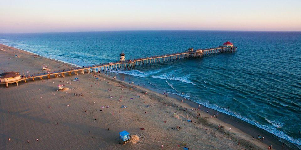 """<p><strong><span>Best for Surfing </span><br></strong></p><p>With a nickname like """"Surf City USA,"""" Huntington Beach is a no-brainer when it comes to hanging 10 (though Santa Cruz's Steamer Lane Beach and Malibu's Surfrider Beach are sweet surfing spots, too). Watch the surfers in action from a perch along <a href=""""https://go.redirectingat.com?id=74968X1596630&url=https%3A%2F%2Fwww.tripadvisor.com%2FAttraction_Review-g32513-d3309900-Reviews-Huntington_Beach_Pier-Huntington_Beach_California.html&sref=https%3A%2F%2Fwww.redbookmag.com%2Flife%2Fg37132327%2Ftop-california-beach-vacations%2F"""" rel=""""nofollow noopener"""" target=""""_blank"""" data-ylk=""""slk:the 1,850-foot-long pier"""" class=""""link rapid-noclick-resp"""">the 1,850-foot-long pier</a>, with the famous '50s-style <a href=""""https://go.redirectingat.com?id=74968X1596630&url=https%3A%2F%2Fwww.tripadvisor.com%2FRestaurant_Review-g32513-d468077-Reviews-Ruby_s_Diner-Huntington_Beach_California.html&sref=https%3A%2F%2Fwww.redbookmag.com%2Flife%2Fg37132327%2Ftop-california-beach-vacations%2F"""" rel=""""nofollow noopener"""" target=""""_blank"""" data-ylk=""""slk:Ruby's Diner"""" class=""""link rapid-noclick-resp"""">Ruby's Diner</a> at the very tip. </p><p><strong><em>Where to Stay:</em></strong> <a href=""""https://go.redirectingat.com?id=74968X1596630&url=https%3A%2F%2Fwww.tripadvisor.com%2FHotel_Review-g32513-d1231115-Reviews-Kimpton_Shorebreak_Hotel-Huntington_Beach_California.html&sref=https%3A%2F%2Fwww.redbookmag.com%2Flife%2Fg37132327%2Ftop-california-beach-vacations%2F"""" rel=""""nofollow noopener"""" target=""""_blank"""" data-ylk=""""slk:Kimpton Shorebreak Resort"""" class=""""link rapid-noclick-resp"""">Kimpton Shorebreak Resort</a>, <a href=""""https://go.redirectingat.com?id=74968X1596630&url=https%3A%2F%2Fwww.tripadvisor.com%2FHotel_Review-g32513-d252509-Reviews-Hyatt_Regency_Huntington_Beach_Resort_Spa-Huntington_Beach_California.html&sref=https%3A%2F%2Fwww.redbookmag.com%2Flife%2Fg37132327%2Ftop-california-beach-vacations%2F"""" rel=""""nofollow noopener"""" target=""""_blank"""" data-ylk=""""sl"""