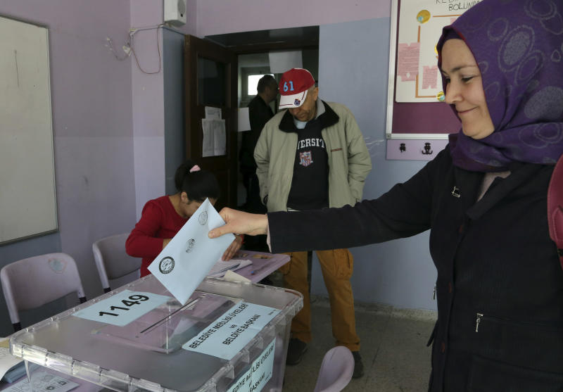 A Turkish woman casts her ballot at a polling station in Ankara Turkey, Sunday, March 30, 2014. More than 52 millions Turks vote in local elections Sunday as Turkish Prime Minister Recep Tayyip Erdogan is fighting corruption allegations against his government. The local elections are seen as a referendum over his rule.(AP Photo/Burhan Ozbilici)