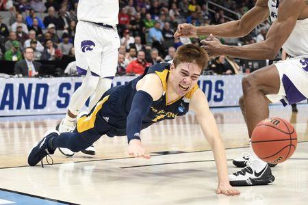 Mar 22, 2019; San Jose, CA, USA; UC Irvine Anteaters guard Robert Cartwright (3) falls as the ball goes loose during the second half in the first round of the 2019 NCAA Tournament against the Kansas State Wildcats at SAP Center. Mandatory Credit: Kelley L Cox-USA TODAY Sports