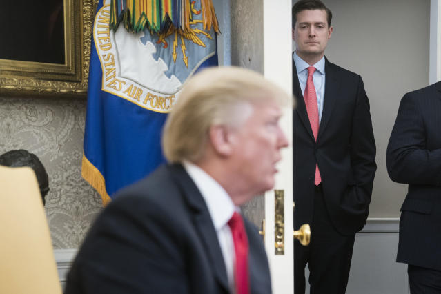 White House staff secretary Rob Porter watches President Trump speak during a meeting in the Oval Office last February. (Photo: Jabin Botsford/The Washington Post via Getty Images)