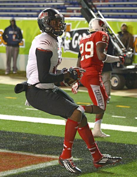 Arkansas State wide receiver Allen Muse (17) reacts after catching a pass for the winning touchdown against Ball State in the fourth quarter of the GoDaddy Bowl NCAA college football game in Mobile, Ala., Sunday, Jan. 5, 2014. (AP Photo/G.M. Andrews)