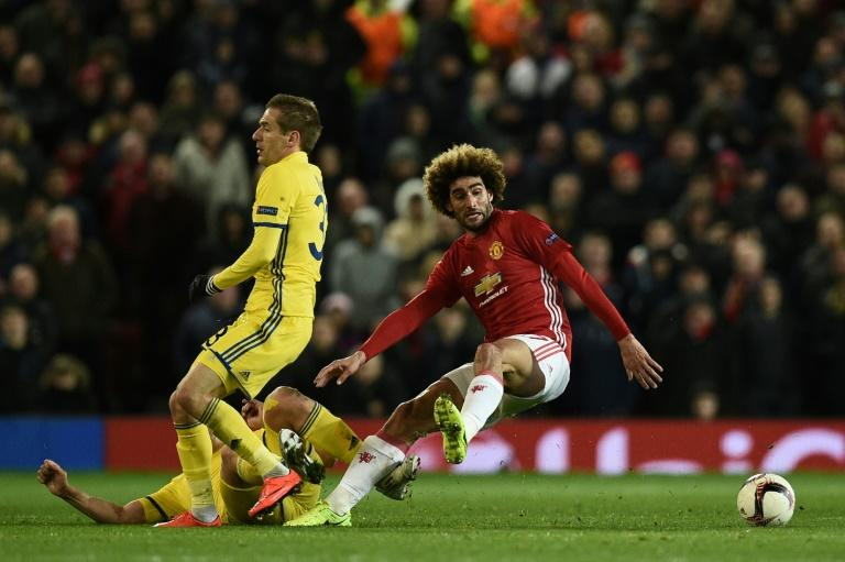 Rostov's Rforward Aleksandr Bukharov (2L) fouls Manchester United's midfielder Marouane Fellaini (R) during the UEFA Europa League round of 16 second-leg football match between Manchester United and FC Rostov on March 16, 2017
