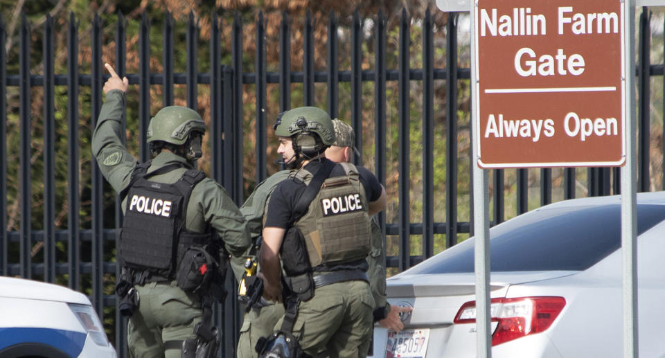 Officers prepare to enter Fort Detrick at the Nallin Farm Gate during the shooting rampage. Source: AP