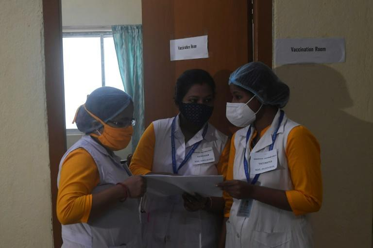 Health officials check details during a drill ahead of coronavirus vaccine delivery at a health centre in Kolkata, India on January 2, 2021
