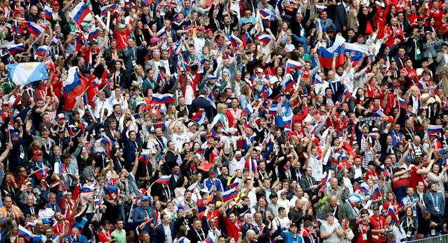 <p>Russia fans celebrate in the stands after the home side go ahead in the opening World Cup game. (Getty) </p>