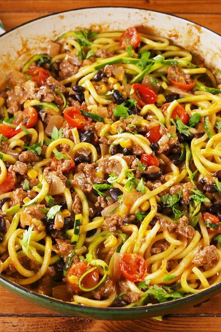 """<p>All your fave burrito flavors in a guilt-free dish.</p><p>Get the recipe from <a href=""""https://www.delish.com/cooking/recipe-ideas/a23067486/burrito-zoodles-recipe/"""" rel=""""nofollow noopener"""" target=""""_blank"""" data-ylk=""""slk:Delish"""" class=""""link rapid-noclick-resp"""">Delish</a>. </p>"""