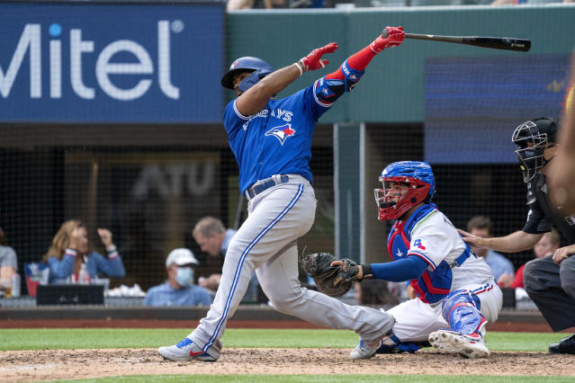 Blue Jays spoil Rangers home opener before largest MLB crowd