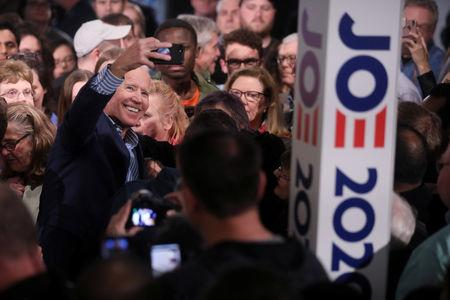 U.S. Democratic presidential candidate former Vice President Joe Biden takes a selfie with people in the crowd after a campaign stop in Des Moines, Iowa, U.S. May 1, 2019.  REUTERS/Jonathan Ernst