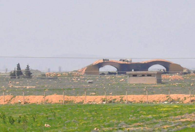 The damaged Shayrat airfield military base targeted US Tomahawk cruise missiles is seen on April 7, 2017, near the Syrian city of Homs (AFP Photo/STRINGER)
