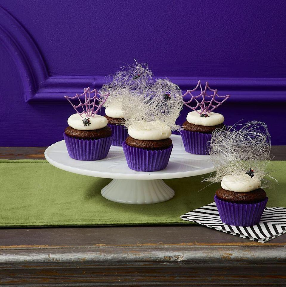"""<p>The spun sugar spider webs that top these chocolate cupcakes are almost too cool-looking to eat!</p><p><em><a href=""""https://www.womansday.com/food-recipes/food-drinks/a29129422/spider-cupcakes-recipe/"""" rel=""""nofollow noopener"""" target=""""_blank"""" data-ylk=""""slk:Get the Spider Cupcakes recipe."""" class=""""link rapid-noclick-resp"""">Get the Spider Cupcakes recipe. </a></em></p>"""