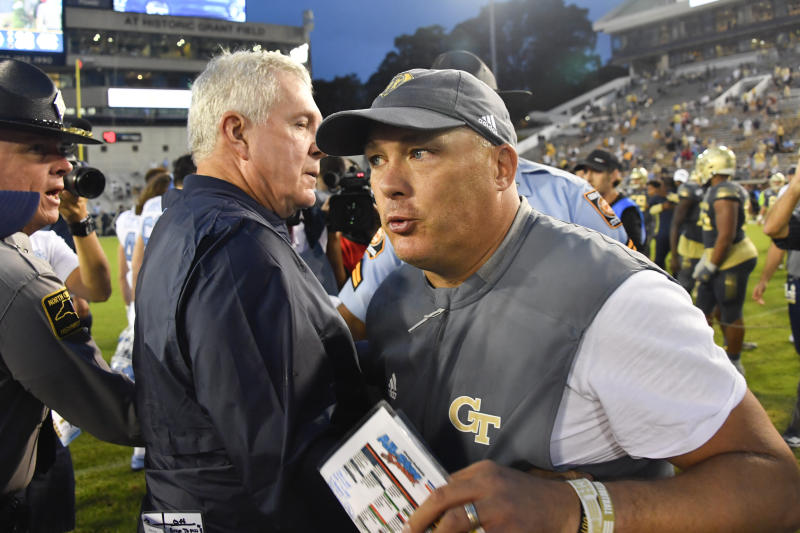 Georgia Tech head coach Geoff Collins, right, and North Carolina head coach Mack Brown meet up after an NCAA college football game a Saturday, Oct. 5, 2019, in Atlanta. (John Amis/Atlanta Journal-Constitution via AP)