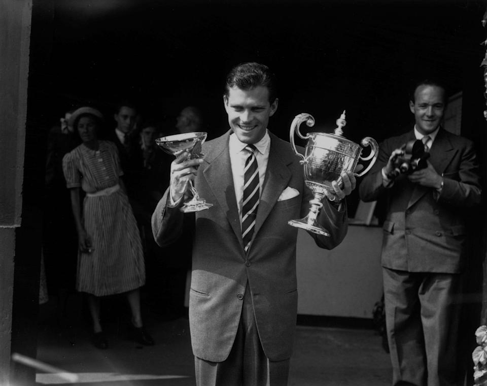 Budge Patty with his men's singles trophy at Wimbledon, July 7 1950 - Reg Speller/Fox Photos/Getty