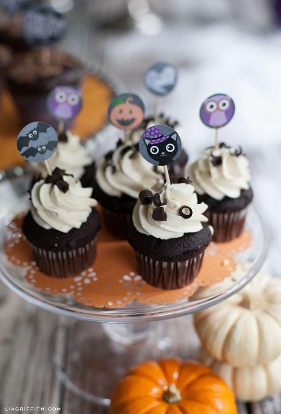 """<p>These printable cupcake toppers are the icing on the cake for your Halloween treats. Print them on sticker sheets or card stock to add color and festivity to your homemade baked goods.</p><p><em><a href=""""https://liagriffith.com/halloween-cupcake-ideas/"""" rel=""""nofollow noopener"""" target=""""_blank"""" data-ylk=""""slk:Get the printable at Lia Griffith »"""" class=""""link rapid-noclick-resp"""">Get the printable at Lia Griffith »</a></em></p><p><strong>RELATED:</strong> <a href=""""https://www.goodhousekeeping.com/holidays/halloween-ideas/g2711/halloween-cupcakes/"""" rel=""""nofollow noopener"""" target=""""_blank"""" data-ylk=""""slk:40+ Seriously Cute (and Creepy) Halloween Cupcake Ideas"""" class=""""link rapid-noclick-resp"""">40+ Seriously Cute (and Creepy) Halloween Cupcake Ideas</a></p>"""