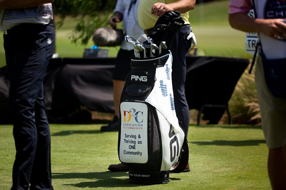 Kirk Triplett's golf bag displays the logo for Dedication to Community, an organization started by former NFL player and FBI agent Quentin Williams, during day two of the Chubb Classic.