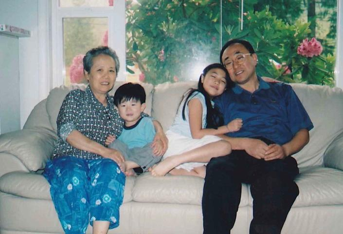 """Joseph and Hannah with their father, Timothy, and grandmother Soon Sun in Washington in 2005. <span class=""""copyright"""">(Kim family)</span>"""