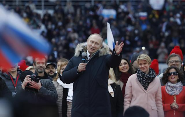<p>Russian President Vladimir Putin delivers a speech during a rally to support his bid in the upcoming presidential election at Luzhniki Stadium in Moscow, Russia, March 3, 2018. (Photo: Maxim Shemetov/Reuters) </p>