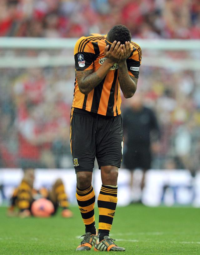 Hull City's English midfielder Tom Huddlestone reacts after losing the English FA Cup final match against Arsenal at Wembly Stadium in London on May 17, 2014 (AFP Photo/Glyn Kirk)