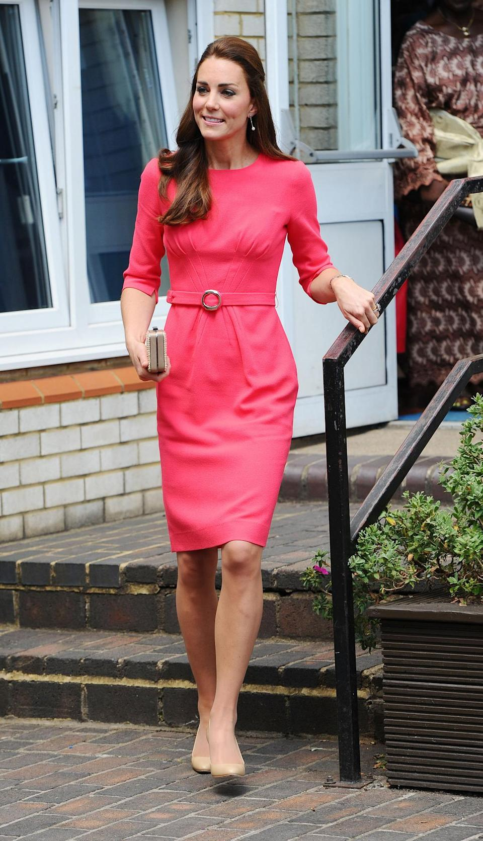 <p>Kate donned a scarlet Goat dress for a visit to a London school. Accessories were by two of her favourite brands, L.K. Bennett (for the clutch) and Jimmy Choo. </p><p><i>[Photo: PA]</i></p>