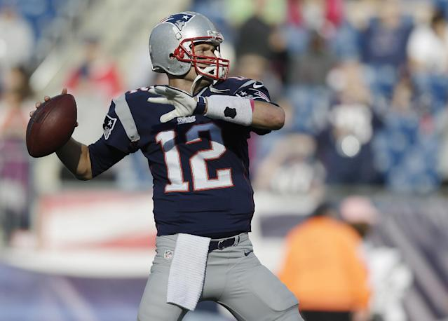 New England Patriots quarterback Tom Brady warms up before an NFL football game against the New Orleans Saints Sunday, Oct.13, 2013, in Foxborough, Mass. (AP Photo/Steven Senne)