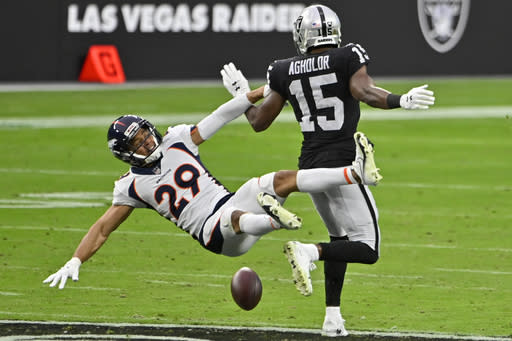 Las Vegas Raiders wide receiver Nelson Agholor (15) misses a pass while covered by Denver Broncos cornerback Bryce Callahan (29) during the first half of an NFL football game, Sunday, Nov. 15, 2020, in Las Vegas. (AP Photo/David Becker)