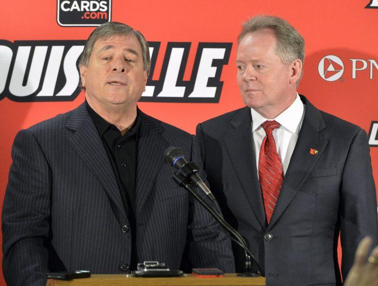 Tom Jurich, left, and Bobby Petrino deny any wrongdoing in the Wake Forest game-plan breach. (AP)