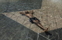 Kais Bothe relaxes in the cool in the city hall pool, as temperatures hit 37 degrees Celsius in Edmonton, Alberta, on Wednesday, June 30, 2021. (Jason Franson/The Canadian Press via AP)