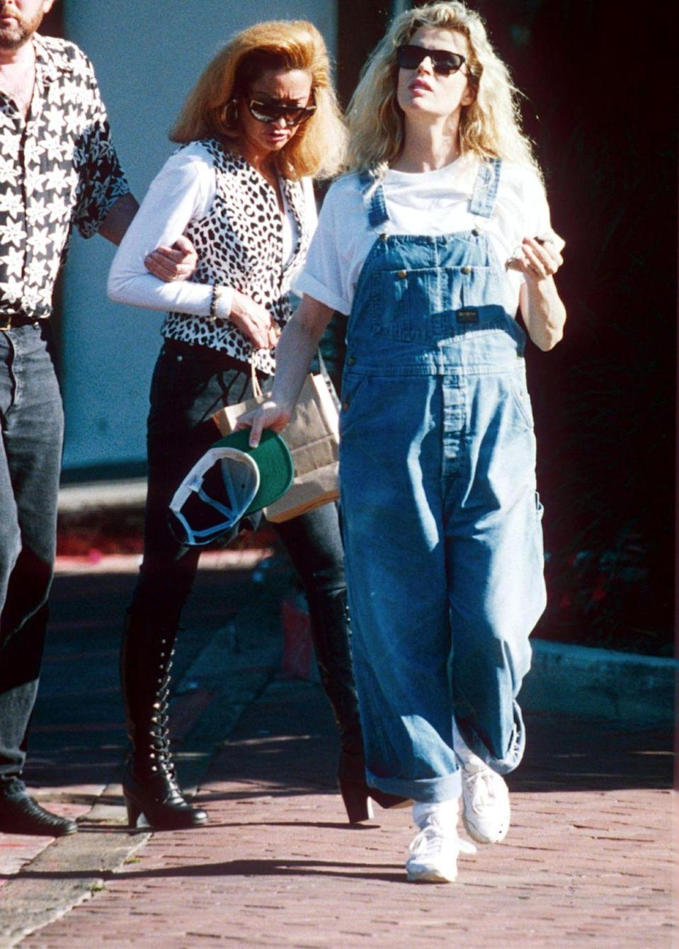 <p>Overalls, like the ones being rocked here by a pregnant Kim Basinger, took over maternity trends in the mid-'90s.</p>