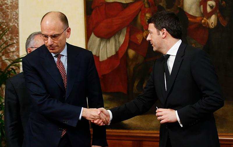 Newly appointed Italian Prime Minister Matteo Renzi (R) shakes hand with his predecessor Enrico Letta at Chigi Palace in Rome February 22, 2014. Italian center-left leader Matteo Renzi promised on Friday to start work on reforms immediately, after he named a new cabinet and formally accepted the mandate to form an administration he said would stay in place until 2018. REUTERS/Tony Gentile (ITALY - Tags: POLITICS) (Photo: Tony Gentile / reuters)