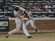 San Francisco Giants' Austin Slater hits a home run during the seventh inning of the team's baseball game against the New York Mets on Wednesday, Aug. 22, 2018, in New York. (AP Photo/Frank Franklin II)