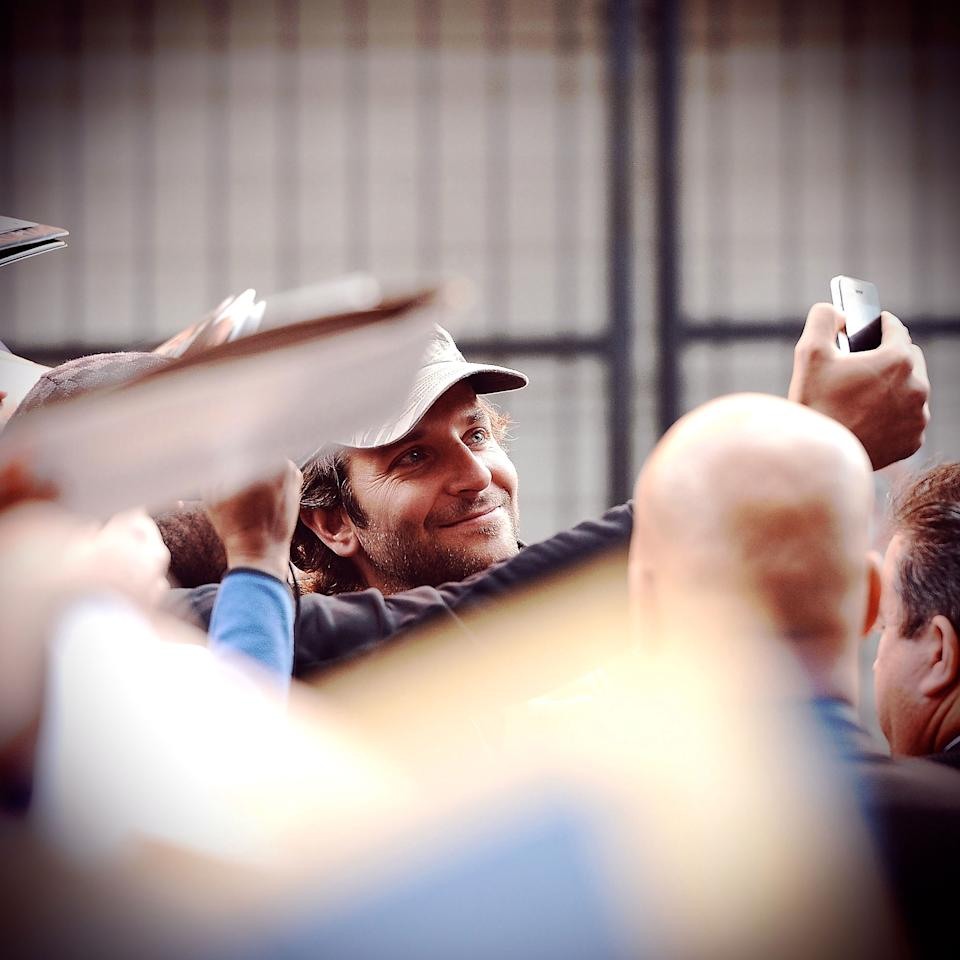 TORONTO, ON - SEPTEMBER 10:  <<(EDITORS NOTE: Image was processed using various digital filters) Actor Bradley Cooper exits the 'Silver Linings Playbook' TIFF press conference on September 9, 2012 in Toronto, Canada.  (Photo by Jason Merritt/Getty Images)