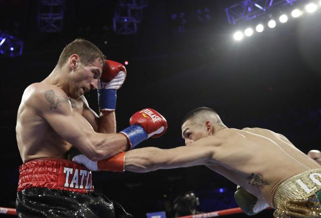 Teofimo Lopez, right, punches Finland's Edis Tatli during the third round of a NABF lightweight championship boxing match Saturday, April 20, 2019, in New York. Lopez stopped Tatli in the fifth round. (AP Photo/Frank Franklin II)