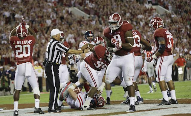 Members of the Alabama defense, including defensive lineman Jeoffrey Pagan (8) and defensive back Jarrick Williams (20), react after Mississippi quarterback Bo Wallace (14) was sacked for a safety in the fourth quarter of an NCAA college football game in Tuscaloosa, Ala., Saturday, Sept. 28, 2013. Alabama won 25-0. (AP Photo/Dave Martin)
