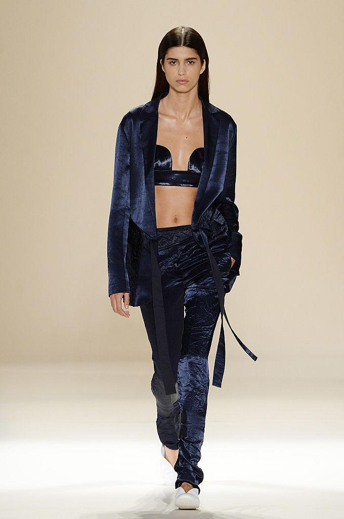 """<p>Back in September 2016, the designer showcased one of our favourite collections to date. Bringing a whole new meaning to the term """"I woke up like this"""", Beckham dressed models in crushed velvet robes and midnight blue ensembles. If only we could afford to go to work dressed head-to-toe in the label – it would sure make getting out of bed on a morning a whole load easier… <em>[Photo: Getty]</em> </p>"""
