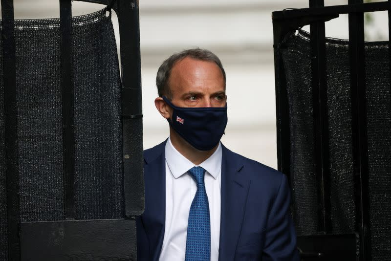 Britain's Foreign Secretary Dominic Raab walks outside Downing Street, in London