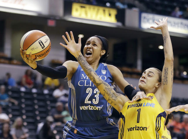 FILE - In this Aug. 30, 2017, file photo, Minnesota Lynx's Maya Moore, left, shoots against Indiana Fever's Jazmon Gwathmey during the first half of a WNBA basketball game in Indianapolis. Moore will sit out a second straight WNBA season in 2020 to continue her push for criminal justice reform. (AP Photo/Darron Cummings, File)