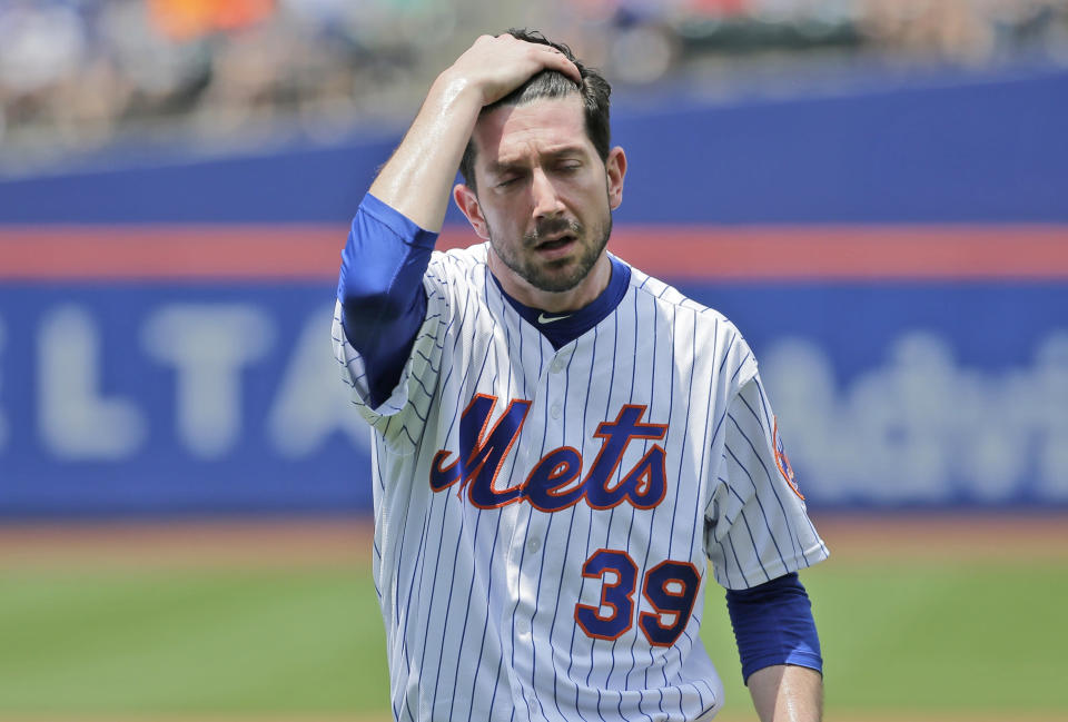 New York Mets pitcher Jerry Blevins leaves the field after the top of the first inning of a baseball game against the Los Angeles Dodgers at Citi Field, Sunday, June 24, 2018, in New York. (AP Photo/Seth Wenig)