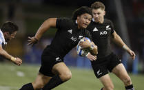 New Zealand's Caleb Clarke run sat the defence during the Tri-Nations rugby test between Argentina and the All Blacks in Newcastle, Australia, Saturday, Nov. 28, 2020. (AP Photo/Rick Rycroft)