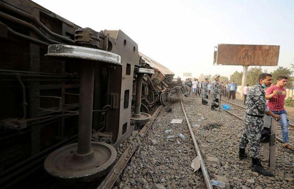 PHOTO: Egyptian police officers stand guard at the site where train carriages derailed in Qalioubia north of Cairo, Egypt, April 18, 2021. (Mohamed Abd El Ghany/Reuters)