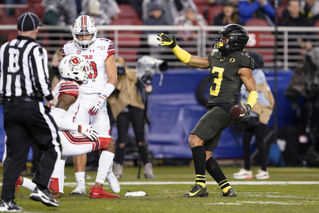 Oregon wide receiver Johnny Johnson III (3) reacts after catching a pass, next to Utah defensive backs R.J. Hubert (10) and Josh Nurse (14) during the first half of the Pac-12 Conference championship NCAA college football game in Santa Clara, Calif., Friday, Dec. 6, 2018. (AP Photo/Tony Avelar)