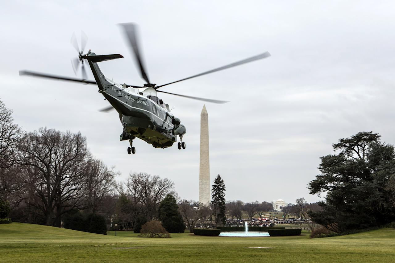 WASHINGTON, DC - DECEMBER 16:  (AFP OUT)  U.S. President Barack Obama aboard Marine One departs the White House to travel to Connecticut December 16, 2012 in Washington, DC. President Obama will meet with the families of victims of the shooting at Sandy Hook Elementary School in Newtown.  (Photo by Brendan Hoffman-Pool/Getty Images)