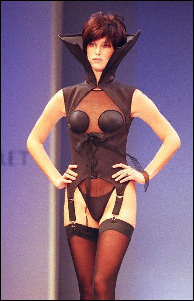 A model wearing a black scuba-diving femme fatale corset at the 1997 Victoria's Secret Spring Revelations Fashion Show, inside the Plaza Hotel in New York.