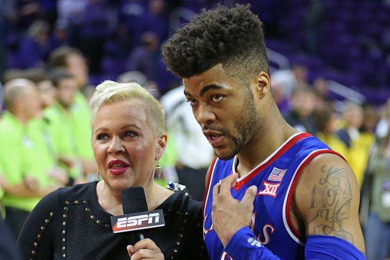 Holly Rowe, pictured with Kansas guard Frank Mason III in February, thanked ESPN for renewing her contract amid her cancer battle.