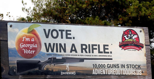 "One of several billboards of a gun raffle promotion at Adventures Outdoors in Smyrna, Georgia, October 25, 2012. The store has promoted the raffle on billboards as a ""Vote. Win a rifle."" but owner Jay Wallace has stated that all Georgia residents are eligible to enter. REUTERS/Tami Chappell (UNITED STATES - Tags: POLITICS ELECTIONS SOCIETY)"
