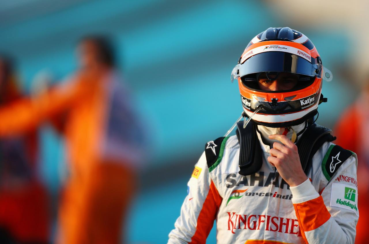ABU DHABI, UNITED ARAB EMIRATES - NOVEMBER 04:  Nico Hulkenberg of Germany and Force India crashes out at the start of the Abu Dhabi Formula One Grand Prix at the Yas Marina Circuit on November 4, 2012 in Abu Dhabi, United Arab Emirates.  (Photo by Paul Gilham/Getty Images)